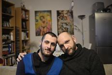 Gay couple Dusan Veselovsky (R), 39, and Libor Marko, 25, pose for a photo in their apartment on the day of a referendum that aims to maintain a ban on same-sex marriage, in Bratislava February 7, 2015.  REUTERS/Radovan Stoklasa