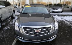 An unsold Cadillac ATS vehicle sits in the front lot of a Cadillac automobile dealership in Plymouth,  Michigan, February 5, 2015. REUTERS/Rebecca Cook