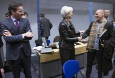 Eurogroup President Jeroen Dijsselbloem (L) looks at Greek Finance Minister Yanis Varoufakis (C) and International Monetary Fund (IMF) Managing Director Christine Lagarde (R) during an extraordinary euro zone Finance Ministers meeting to discuss Athens' plans to reverse austerity measures agreed as part of its bailout, in Brussels February 11, 2015.  REUTERS/Yves Herman