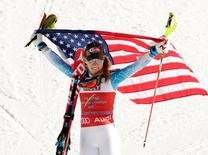 Feb 14, 2015; Beaver Creek, CO, USA; Mikaela Shiffrin of the United States celebrates with an American flag at the flower ceremony after the  women's slalom in the FIS alpine skiing world championships at Raptor Racecourse. Mandatory Credit: Erich Schlegel-USA TODAY Sports