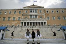 Greek Presidential guards perform during a change of shift at the Tomb of the Unknown Soldier in Athens February 18, 2015. REUTERS/Alkis Konstantinidis