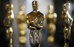 Actual Oscar statuettes to be presented during the Annual Academy Awards sit in a display case in Hollywood February 22, 2008. REUTERS/Gary Hershorn/Files