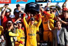 Feb 22, 2015; Daytona Beach, FL, USA; NASCAR Sprint Cup Series driver Joey Logano (22) celebrate with Harley J. Earl Trophy after winning the Daytona 500 at Daytona International Speedway. Mandatory Credit: Jasen Vinlove-USA TODAY Sports