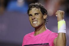 Rafael Nadal of Spain celebrates after winning match against Pablo Cuevas of Uruguay during their men's singles tennis match at the Rio Open tournament in Rio de Janeiro, February 21, 2015. REUTERS/Ueslei Marcelino (BRAZIL - Tags: SPORT TENNIS)