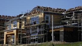 Scaffolding is seen at the construction site of a new home in Carlsbad, California September 22, 2014.    REUTERS/Mike Blake