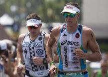 Professional male triathletes Pete Jacobs of Australia (R) and Ben Hoffman of the U.S. leave the transition and start the marathon portion of the Ironman World Championship in Kailua-Kona, Hawaii, October 12, 2013. REUTERS/Hugh Gentry