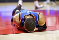 Oklahoma City Thunder guard Russell Westbrook (0) lies on the court during the fourth quarter against the Portland Trail Blazers at the Moda Center. Mandatory Credit: Craig Mitchelldyer-USA TODAY Sports