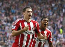 Adam Johnson comemora gol do Sunderland contra o Tottenham Hotspur. 13/09/2014.   REUTERS/Andrew Yates
