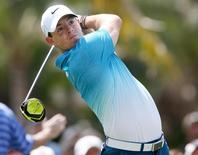 Mar 5, 2015; Miami, FL, USA; Rory McIlroy hits his tee shot on the twelfth hole during the first round of the WGC - Cadillac Championship golf tournament at TPC Blue Monster at Trump National Doral. Mandatory Credit: Jason Getz-USA TODAY Sports
