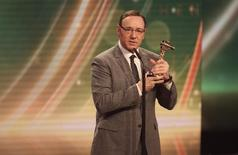 Actor Kevin Spacey holds his Best International Actor award at the 'Die Goldene Kamera' (Golden Camera) awards ceremony in Hamburg, February 27, 2015.  REUTERS/Christian Charisius/Pool