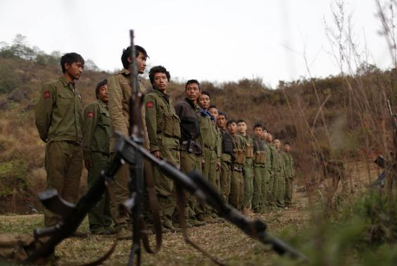 Rebel soldiers of Myanmar National Democratic Alliance Army (MNDAA) gather at a military base in Kokang region, March 11, 2015.  REUTERS/Stringer