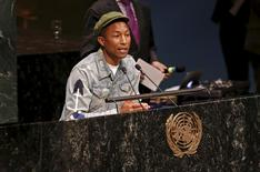 """Musician Pharrell Williams addresses youth gathered in the United Nations General Assembly hall on the occasion of the International Day of Happiness on the theme """"Young People in Support of Climate Action"""" at U.N. headquarters in New York, March 20, 2015. REUTERS/Mike Segar"""