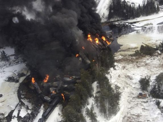 Smoke rises from fires caused by the derailment of a CN Railway train carrying crude oil near the northern Ontario community of Gogama, Ontario in this March 7, 2015 Transport Safety Board of Canada handout file photograph. REUTERS/TSBCANADA/HANDOUT VIA REUTERS