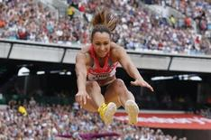 Great Britain's Jessica Ennis-Hill competes before winning the women's long jump event at the London Diamond League 'Anniversary Games' athletics meeting in east London July 27, 2013.  REUTERS/Suzanne Plunkett