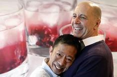 Bob Tobin (R) and Hitoshi Ohashi, a same-sex couple, pose for pictures after an interview with Reuters at their house in Tokyo February 25, 2015. REUTERS/Yuya Shino