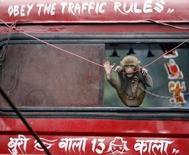 A pet monkey rides on a recovery truck in Kolkata in this July 28, 2009 file photo. REUTERS/Parth Sanyal/Files