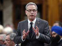 Canada's Finance Minister Joe Oliver stands to speak during Question Period in the House of Commons on Parliament Hill in Ottawa March 10, 2015. REUTERS/Chris Wattie
