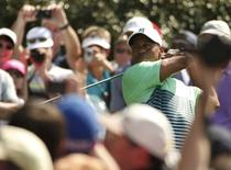 Tiger Woods of the U.S. hits off the 15th tee during his practice round ahead of the 2015 Masters at Augusta National Golf Course in Augusta, Georgia April 8, 2015.  REUTERS/Phil Noble