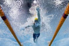 File photo of James Magnussen of Australia seen underwater as he swims in the men's 100m Freestyle final during the 2014 Commonwealth Games in Glasgow, Scotland, July 27, 2014. REUTERS/Stefan Wermuth