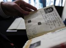 Dutch Minister of Education Ronald Plasterk looks at a facsimile of Anne Frank's dairy after a news conference in Amsterdam June 11, 2009. REUTERS/Cris Toala Olivares
