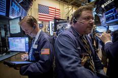 Traders work on the floor of the New York Stock Exchange April 6, 2015. REUTERS/Brendan McDermid