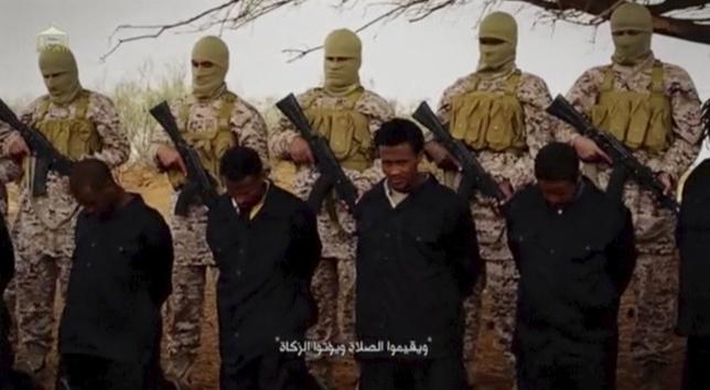 Islamic State militants stand behind what are said to be Ethiopian Christians in Wilayat Fazzan, in this still image from an undated video made available on a social media website on April 19, 2015. Reuters was not able to verify the authenticity of the video but the killings resemble past violence carried out by Islamic State. REUTERS/Social Media Website via Reuters TV