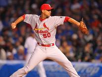 St. Louis Cardinals starting pitcher Adam Wainwright (50) delivers a pitch during the first inning against the Chicago Cubs at Wrigley Field. Mandatory Credit: Dennis Wierzbicki-USA TODAY Sports