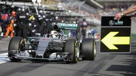 Mercedes Formula One Driver Lewis Hamilton of Britain comes into the pits for a tyre change during the Australian Formula One Grand Prix in Melbourne, March 15, 2015.  REUTERS/Mark Dadswell