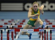 Sally Pearson of Australia competes during the women's 60 metres hurdles heats event at the world indoor athletics championships at the ERGO Arena in Sopot March 7, 2014. REUTERS/Dylan Martinez