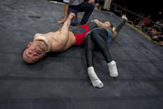 Two Doglegs fighters with cerebral palsy Tetsuya Nagashima (L) and Senjo no Yukiina battle during the making of the documentary film Doglegs in Japan in this October 8, 2011 handout photo. REUTERS/Alfie Goodrich/Handout via Reuters