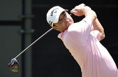 May 9, 2015; Ponte Vedra Beach, FL, USA; Kevin Kisner hits his tee shot on the 1st hole during the third round of The Players Championship golf tournament at TPC Sawgrass - Stadium Course. Mandatory Credit: John David Mercer-USA TODAY Sports