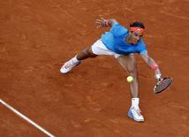 Spain's Rafael Nadal tries to return the ball to Britain's Andy Murray during their final match at the Madrid Open tennis tournament in Madrid, Spain, May 10, 2015. REUTERS/Andrea Comas