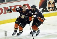 Anaheim Ducks right wing Corey Perry (10) celebrates with left wing Patrick Maroon (19) after scoring the game winning goal during overtime against the Calgary Flames in game five of the second round of the 2015 Stanley Cup Playoffs at Honda Center. Kelvin Kuo-USA TODAY Sports