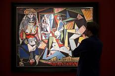"A man pauses to look at Pablo Picasso's ""Les femmes d'Alger (Version 'O')"" (Women of Algiers), estimated at $140 million, at a media preview for Christie's May 11 impressionist, modern and contemporary art sale in the Manhattan borough of New York May 1, 2015. REUTERS/Darren Ornitz"
