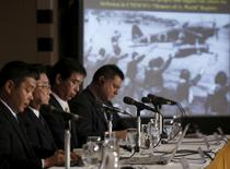 Kampei Shimoide (2nd L), mayor of Minamikyushu city, attends a news conference next to a screen showing a picture of local female students seeing off a kamikaze suicide pilot on April 12 in 1945, at the Foreign Correspondents' Club of Japan in Tokyo May 13, 2015. REUTERS/Yuya Shino