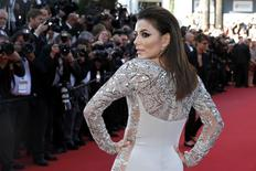 """Actress Eva Longoria poses on the red carpet as she arrives for the screening of the animated film """"Inside Out"""" (Vice Versa) out of competition at the 68th Cannes Film Festival in Cannes, southern France, May 18, 2015.         REUTERS/Benoit Tessier"""