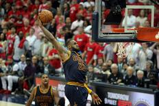Cleveland Cavaliers forward LeBron James (23) dunks against the Atlanta Hawks during the fourth quarter of game one of the Eastern Conference Finals of the NBA Playoffs at Philips Arena. Cleveland won 97-89. Mandatory Credit: Brett Davis-USA TODAY Sports