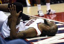 Atlanta Hawks forward DeMarre Carroll (5) reacts after an apparent injury during the fourth quarter of game one of the Eastern Conference Finals of the NBA Playoffs against the Cleveland Cavaliers at Philips Arena; May 20, 2015; Atlanta, GA, USA; Dale Zanine-USA TODAY Sports