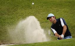 Ignacio Garrido of Spain hits from a bunker on the 15th hole during the third round of the Estoril Portuguese Open golf tournament in Sintra June 12, 2010.  REUTERS/Rafael Marchante