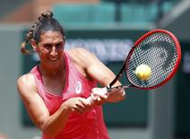 Virginie Razzano of France plays a shot to Veronica Cepede Royg of Paraguay during their women's singles match at the French Open tennis tournament at the Roland Garros stadium in Paris, France, May 25, 2015.   REUTERS/Pascal Rossignol