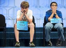 Cole Shafer-Ray (L) of Oklahoma City, Oklahoma, and Siddharth Krishnakumar of Houston, Texas, wait their turn to spell a word during the final round of the 88th annual Scripps National Spelling Bee at National Harbor, Maryland May 28, 2015.      REUTERS/Joshua Roberts