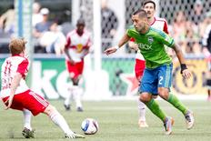 Seattle Sounders FC forward Clint Dempsey (2) dribbles against the New York Red Bulls during the second half at CenturyLink Field. Mandatory Credit: Joe Nicholson-USA TODAY Sports