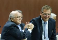 FIFA President Sepp Blatter (L) and Jerome Valcke, Secretary General of the FIFA do a Handshake For Peace at the 65th FIFA Congress in Zurich, Switzerland, May 29, 2015. REUTERS/Ruben Sprich