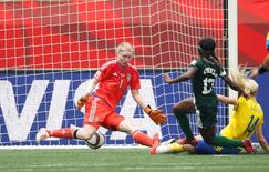 Jun 8, 2015; Winnipeg, Manitoba, CAN; Nigeria forward Francisca Ordega (17) scores against Sweden goalkeeper Hedvig Lindahl (1) in a Group D soccer match in the 2015 women's World Cup at Winnipeg Stadium. Mandatory Credit: USA TODAY Sports Images