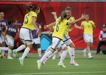 Colombia midfielder Daniela Montoya (6) celebrates with midfielder Natalia Gaitan (3) after scoring a goal against Mexico during the second half in a Group F soccer match in the 2015 FIFA women's World Cup at Moncton Stadium. Mandatory Credit: Matt Kryger-USA TODAY Sports