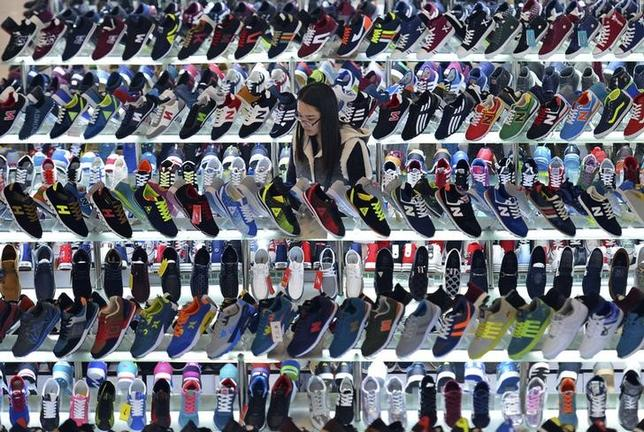 A customer shops for shoes at a mall in Hefei, Anhui province, March 10, 2015. REUTERS/Stringer/Files