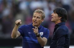 Coaches Joachim Loew of Germany and Juergen Klinsmann (L) of the U.S. chat before their international friendly soccer match in Cologne, Germany June 10, 2015. REUTERS/Ina Fassbender