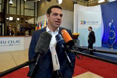 """Le Pre mer ministre grec, Alexis Tsipras, à Bruxelles. Le Fonds monétaire international (FMI) a fait état jeudi de """"divergences majeures"""" avec la Grèce et jugé que les différentes parties étaient """"bien loin"""" d'un accord pour éviter à ce pays un défaut sur sa dette. /Photo prise le 11 juin 2015/REUTERS/Eric Vidal"""