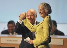 FIFA President Sepp Blatter (L) holds the hand of Bente Erichsen, director of the Nobel Peace Center, during the 62nd FIFA Congress in Budapest May 25, 2012.  REUTERS/Stringer