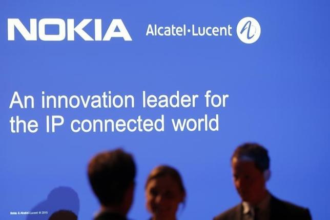 Media people attend a news conference with Nokia and Alcatel-Lucent in Paris April 15, 2015. REUTERS/Charles Platiau/Files